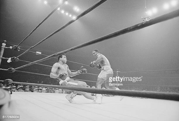 Boxer Joe Frazier knocking out Mohammad Ali during the heavyweight title match in 1971. Frazier won the match and became the heavyweight champion.