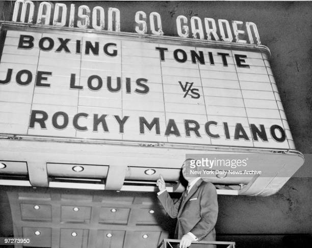 """Boxer Joe Louis in front of marquee at Madison Square Garden. The marquee was set up for the filming of """"The Joe Louis Story."""""""