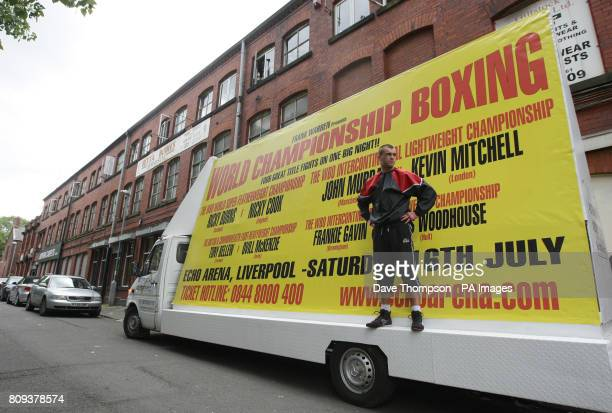 Boxer John Murray stands on a lorry with a billboard promoting his next fight before a Media Work Out at Betta Bodies Gym in Denton Manchester