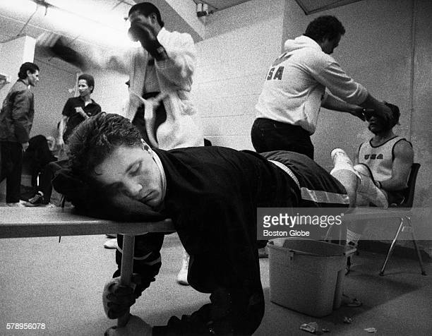 Boxer John Scully center naps on a bench before his bout New England Golden Gloves Championships match in Lowell Mass on Tuesday night Feb 22 1988