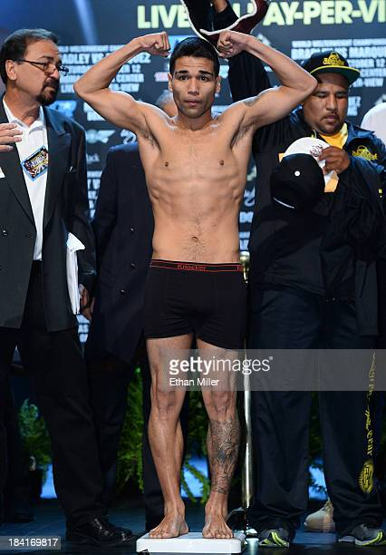 Boxer Jose Ramirez poses on the scale during the official weighin for his bout against Vasyl Lomachenko at the Encore Theater at Wynn Las Vegas on...