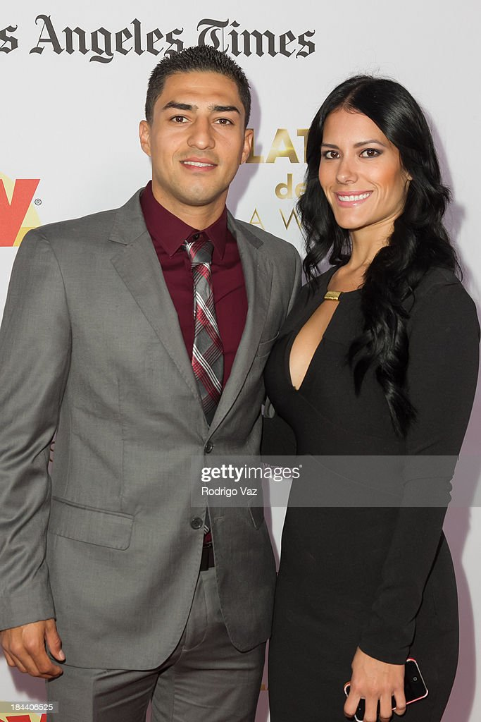 Boxer Josesito Lopez (L) arrives at the 2013 Latinos De Hoy Awards at Los Angeles Times Chandler Auditorium on October 12, 2013 in Los Angeles, California.