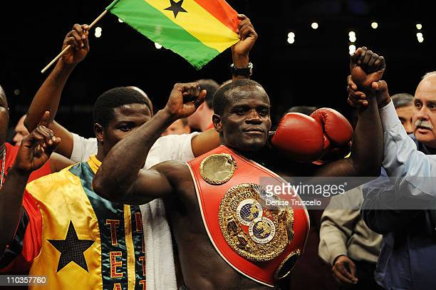 Boxer Josh Clottey celebrates winning the IBF World Welterweight Title against Zab Judah at the Pearl in The Palms Casino Resort on August 2, 2008 in...
