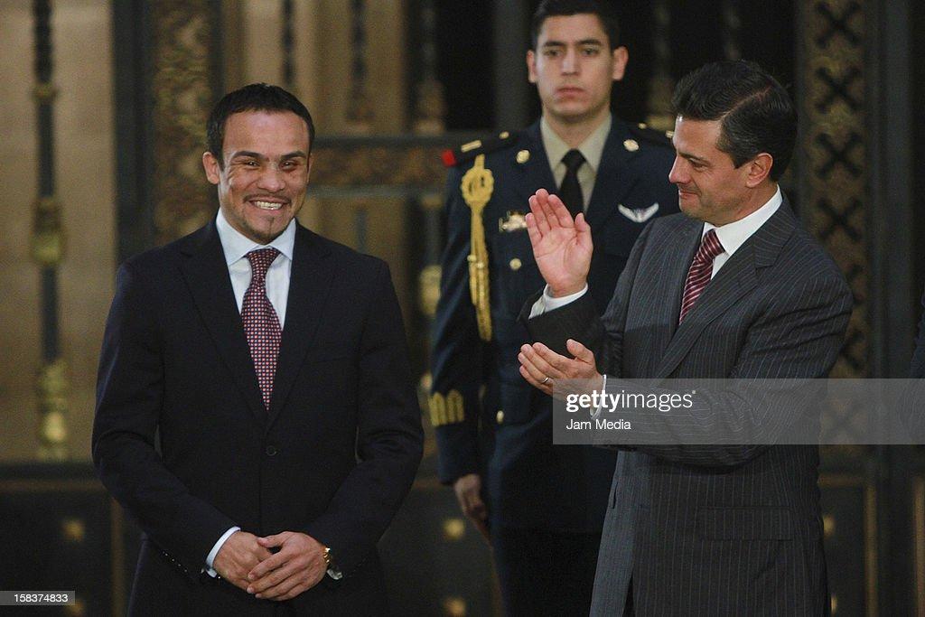 Boxer Juan Manuel Marquez and the President of Mexico Enrique Peña Nieto pose at Palacio Nacional on December 14, 2012 in Mexico City, Mexico.