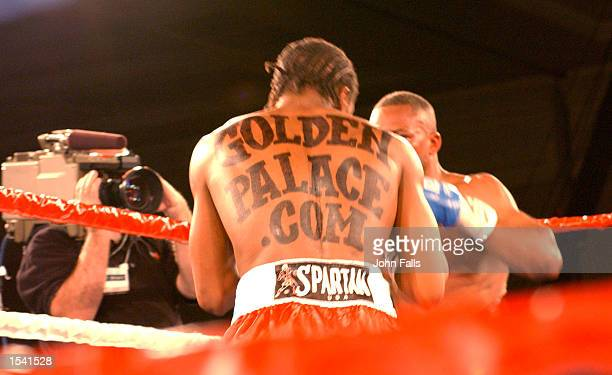 Boxer Kassim Ouma wears a temporary henna tattoo on his back during a fight for the USBA middleweight championship May 10 2002 in Dover DE Ouma and...