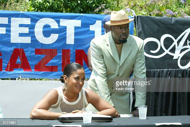 Boxer Laila Ali and her husband boxing promoter Johnny McClain pose at a press conference to announce Ali vs Martin Who's The Greatest a boxing match...