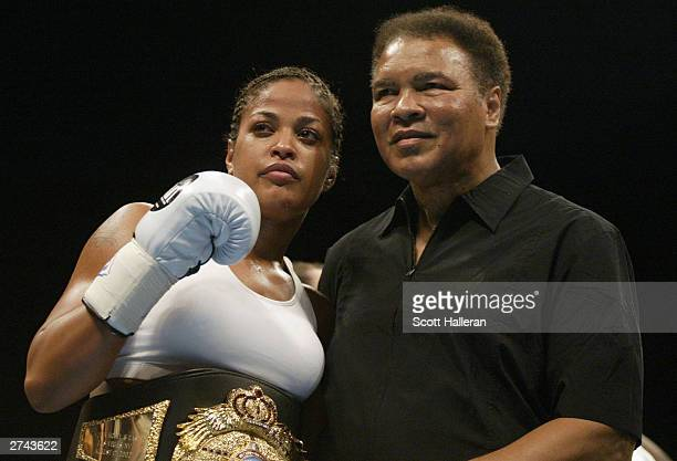Boxer Laila Ali poses with her father former heavyweight champion Muhammad Ali after she defeated Suzy Taylor in two rounds at the Aladdin Casino in...