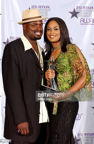 Boxer Laila Ali poses with her husband Johnny McClain and her Best Female Athlete Award backstage during the 2nd Annual BET Awards on June 25 2002 at...
