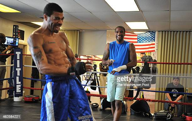 Boxer Lamont Peterson R and brother Anthony Peterson L share a laugh as they prepare to train in the weeks leading up to Lamont's 2012 fight with...