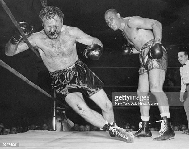 Boxer Lee Savold is knocked out by Joe Louis Savold dropped in the sixth round of a scheduled 15round bout at Madison Square Garden