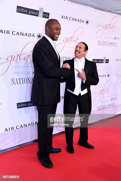 Boxer Lennox Lewis and Actor Danny Trejo attend the 2015 Toronto International Film Festival 'AMBI Gala' at the Four Seasons Hotel on September 9...