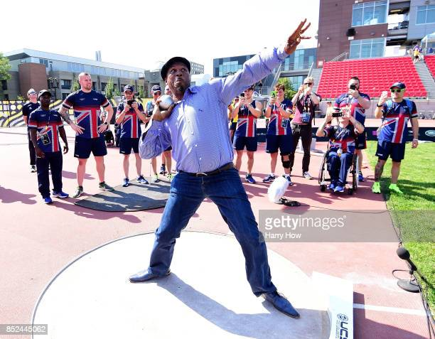 Boxer Lennox Lewis of England demonstrates his shot put ability for Team Great Britain athletes at a training session during the Invictus Games 2017...