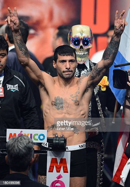 Boxer Lucas Matthysse poses on the scale during the official weighin for his bout against WBC/WBA junior welterweight champion Danny Garcia at the...