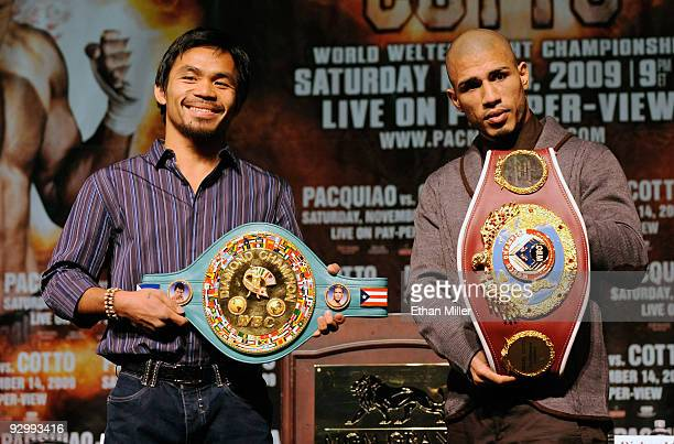 Boxer Manny Pacquiao and WBO welterweight champion Miguel Cotto pose during the final news conference for their bout at the MGM Grand Hotel/Casino...
