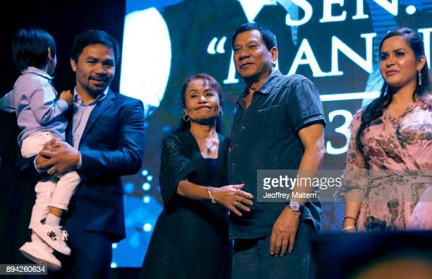 Boxer Manny Pacquiao is seen along with President Rodrigo Roa Duterte and his family as he celebrates his 39th birthday at KCC convention center on...
