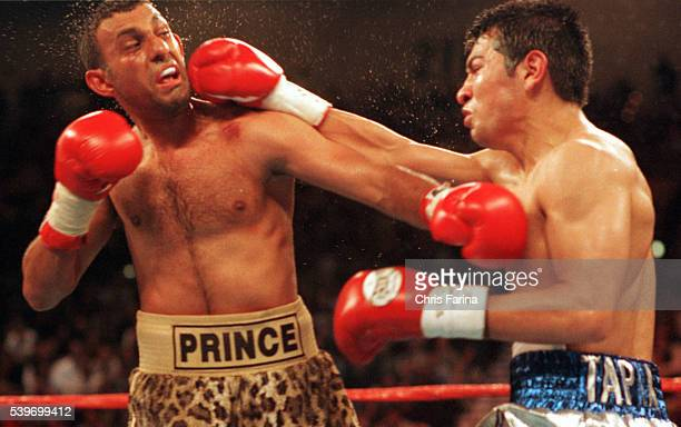 Boxer Marco Antonio Barrera defeats Prince Naseem Hamed with a unanimous decision to become the new IBO Featherweight Champion