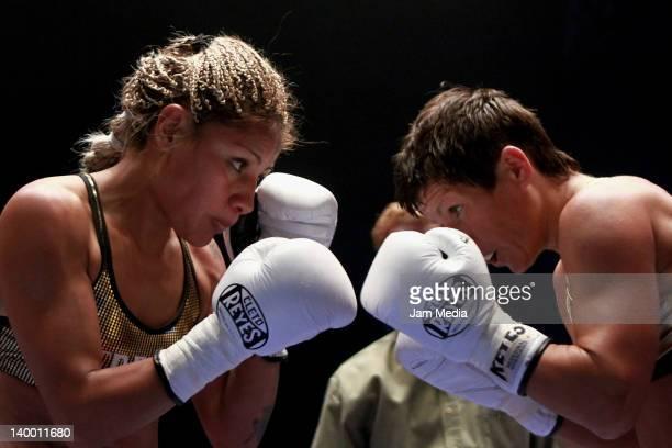 Boxer Mariana Juarez of Mexico and Anastasia Toktaulova of Rusia for the World flyweight title WBC at Arena Mexico on February 25 2012 in Mexico City...