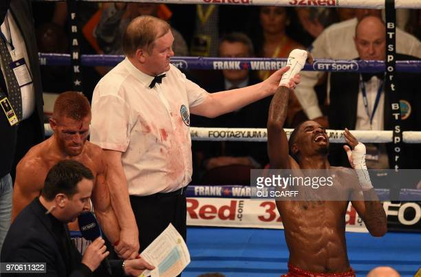 TOPSHOT US boxer Maurice Hooker celebrates victory over Britain's Terry Flanagan following their contest for the vacant WBO World SuperLightweight...