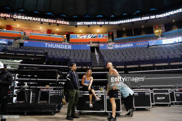 Boxer Mikaela Mayer talks with manager George Ruiz and fighter Trey Lippe Morrison before the start of the weigh in at the Chesapeake Energy Arena on...