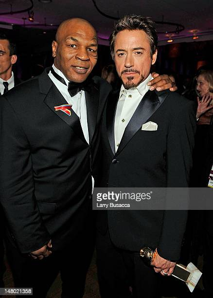 Boxer Mike Tyson and actor Robert Downey Jr attend the InStyle and Warner Bros 67th Annual Golden Globes postparty held at the Oasis Courtyard at The...