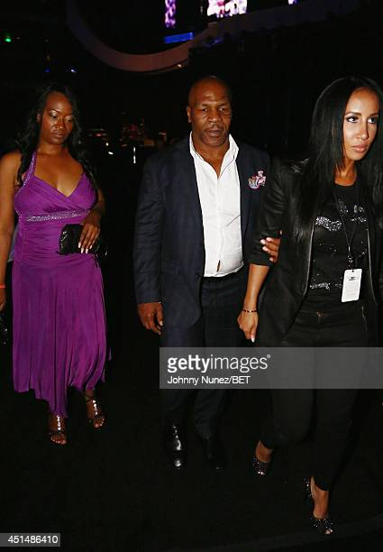 Boxer Mike Tyson and Lakiha Spicer attend the BET AWARDS '14 at Nokia Theatre LA LIVE on June 29 2014 in Los Angeles California