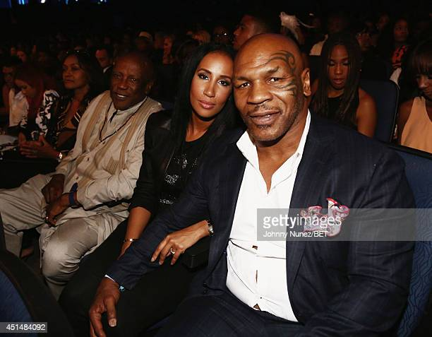 Boxer Mike Tyson and Lakiha Spicer pose in the audience at the BET AWARDS '14 at Nokia Theatre L.A. LIVE on June 29, 2014 in Los Angeles, California.