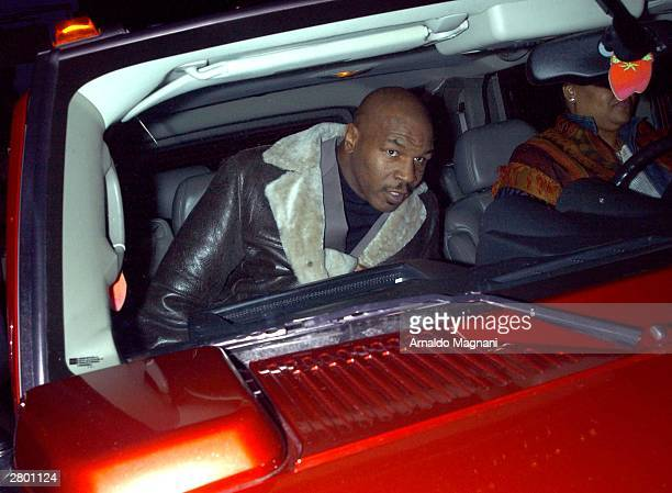 Boxer Mike Tyson climbs into his Hummer sport utility vehicle December 10 2003 in midtown New York City