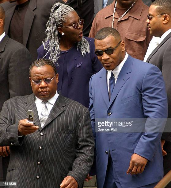 Boxer Mike Tyson exits the funeral service for the late RB singer Aaliyah August 31 2001 at St Ignatius Loyola Church in New York City The 22yearold...