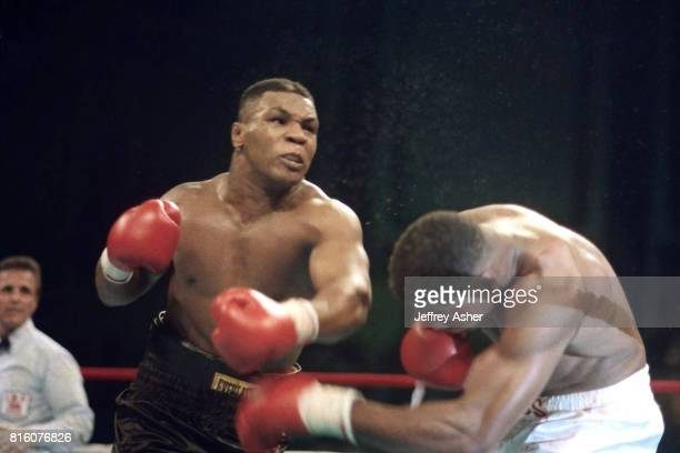 Boxer Mike Tyson knocks Tyrell Biggs to the canvas at Tyson vs Biggs Convention Hall in Atlantic City New Jersey October 16th 1987