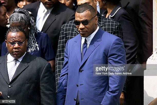 Boxer Mike Tyson leaves St Ignatius Loyola Roman Catholic Church on E 84th St after attending funeral service for RB star Aaliyah The 22yearold...