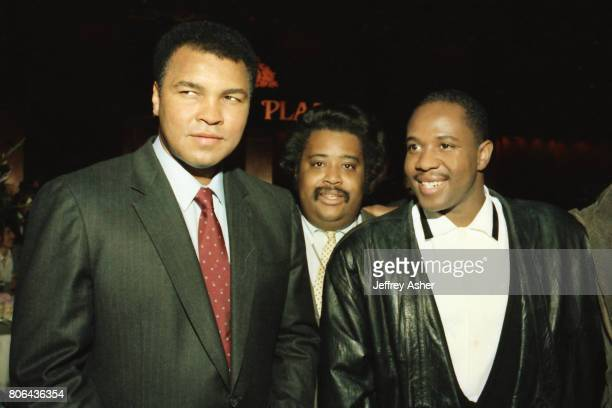 Boxer Muhammad Ali and Reverend Al Sharpton with RnB singer Freddie Jackson at Tyson vs Holmes Convention Hall in Atlantic City New Jersey January 22...
