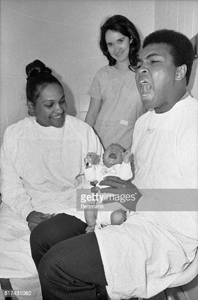 Boxer Muhammad Ali holds his first baby son Muhammad Eban Ali while his wife Belinda looks on at Women's Medical Hospital in Philadelphia The child...