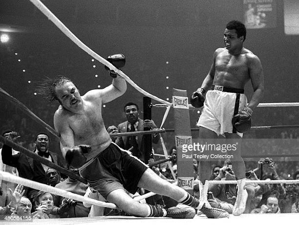 Boxer Muhammad Ali sends opponent Chuck Wepner into the ropes and to the canvas during the 15th round of a heavyweight title fight on March 24 1975...