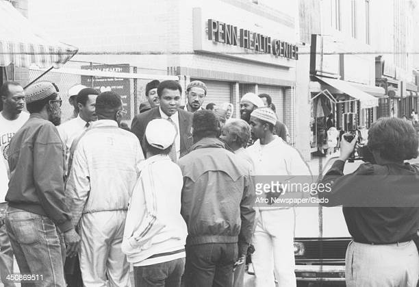 Boxer Muhammad Ali stands in front of the Penn Health Center surrounded by members of the Nation of Islam 1975