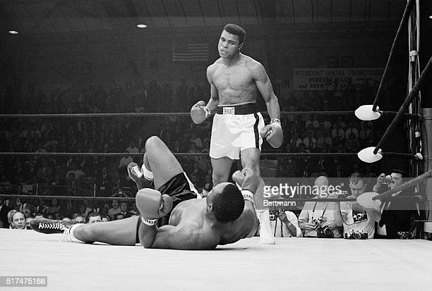 Boxer Muhammad Ali stands over boxer Sonny Liston after knocking him down during the first round of their match Clay won the May 25 1965 fight and...