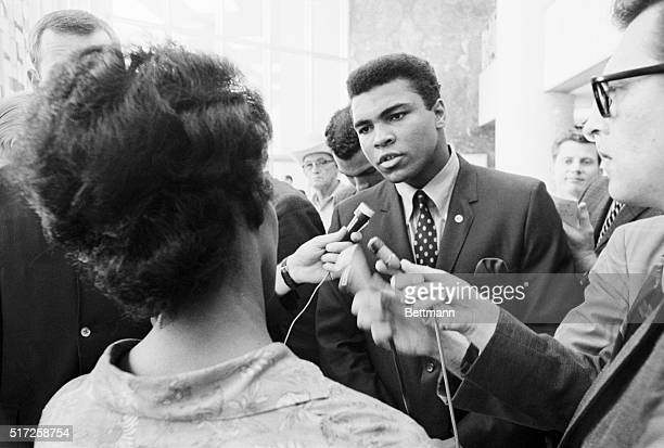 Boxer Muhammad Ali talking with the press after being indicted by a Federal Grand Jury for his refusal to be inducted into the armed forces. Ali...