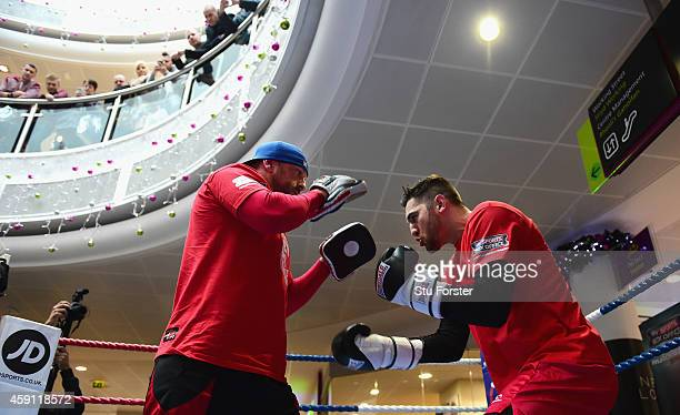 Boxer Nathan Cleverly in action with his trainer Darren Wilson ahead of his fight against Tony Bellew at the Queens Arcade on November 17, 2014 in...