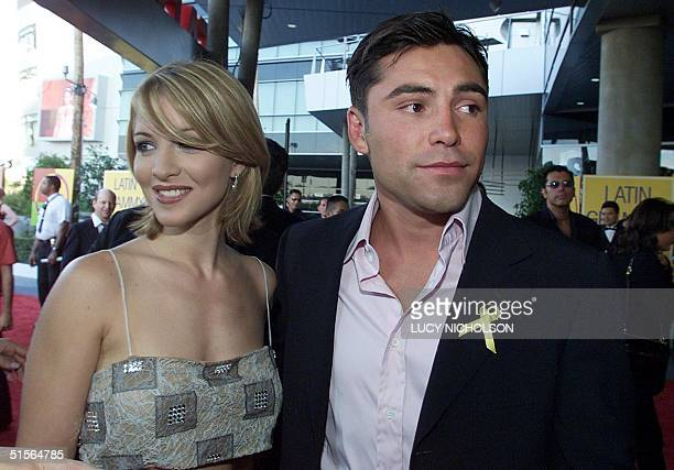 Boxer Oscar De La Hoya and girlfriend Mille Corretger arrive at the first annual Latin Grammy Awards at the Staples Center in Los Angeles 13...