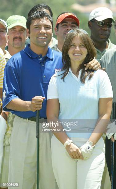 Boxer Oscar De La Hoya and his wife Millie Corretjer attend the Fifth Annual Oscar De La Hoya Celebrity Golf Classic at the North Ranch Country Club...