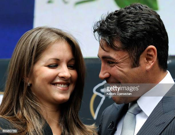 Boxer Oscar De La Hoya and his wife Millie Corretjer smile after he announced his retirement from boxing on April 14 2009 in Los Angeles California