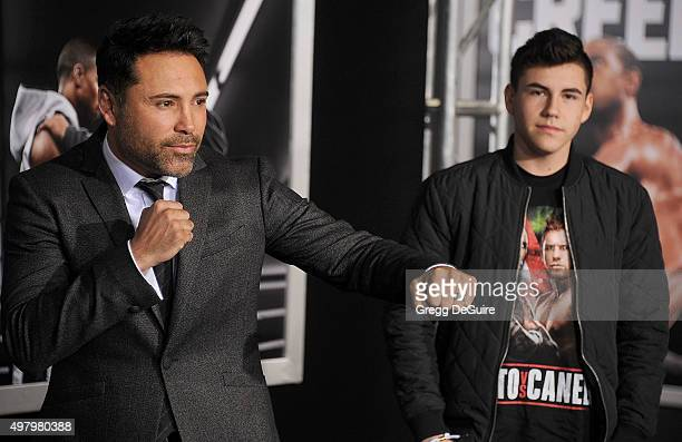 Boxer Oscar De La Hoya and son Devon De La Hoya arrive at the premiere of Warner Bros Pictures' Creed at Regency Village Theatre on November 19 2015...