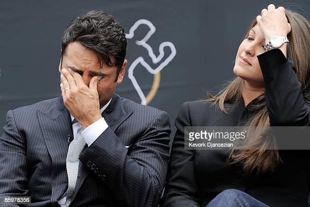 Boxer Oscar De La Hoya reacts after announcing his retirement from boxing as his wife Millie Corretjer looks on April 14 2009 at Staples Center in...