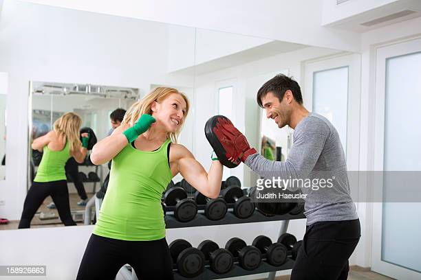 boxer practicing with trainer in gym - punching stock pictures, royalty-free photos & images