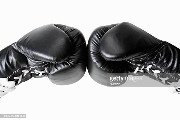 Boxer pressing gloves together, close-up of gloves