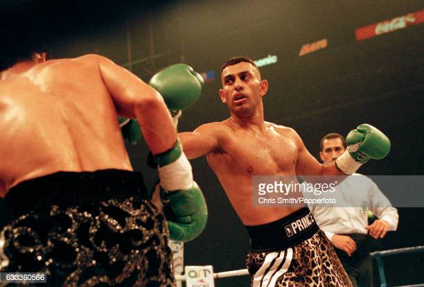 Boxer Prince Naseem Hamed of Great Britain in action watched by referee Mike Ortega during his WBO featherweight championship fight against Jose...