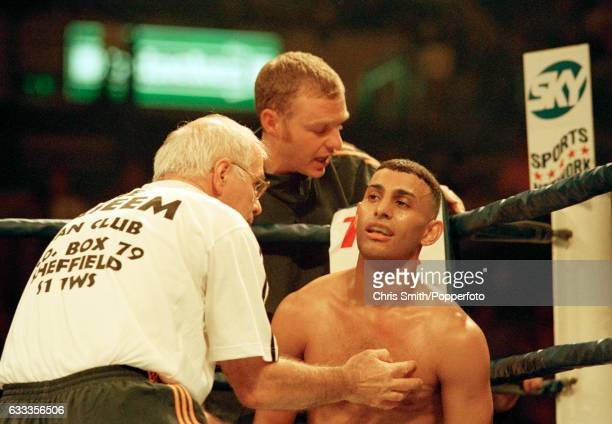 Boxer Prince Naseem Hamed of Great Britain with his corner Brendan Ingle during his WBO featherweight championship fight against Jose Badillo of...