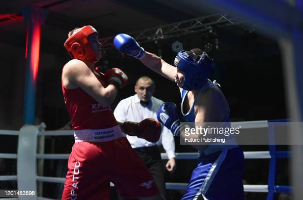 Boxer punches his opponent during the boxing tournament between the athletes of Luhansk and Kharkiv Regions, Sievierodonetsk, Luhansk Region, eastern...