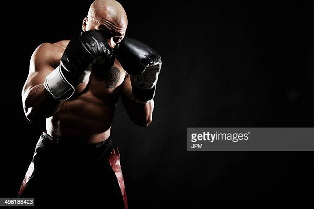 boxer punching - boxing stock pictures, royalty-free photos & images