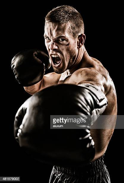 Boxer punching with his gloves