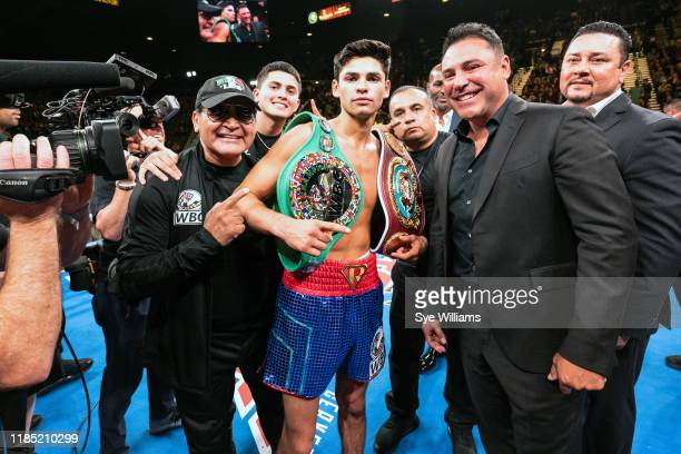 Boxer Ryan Garcia poses with Henry Garcia , Sean Garcia , Oscar De La Hoya , and Eric Gomez after winning his fight against Romero Duno at the MGM...